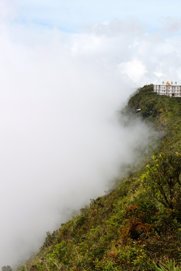 Cloud rolling up the mountainside