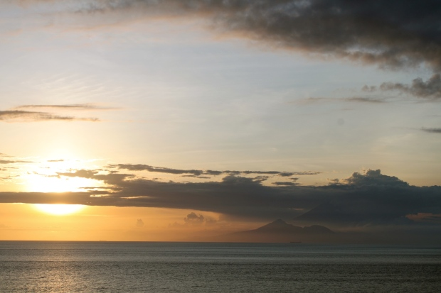 Sunset view from Lombok, you can see the mountains in Bali - just