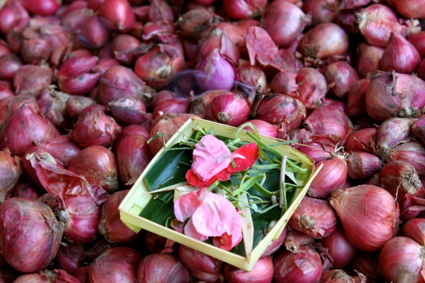 Incense in the onions at the market in western Ubud