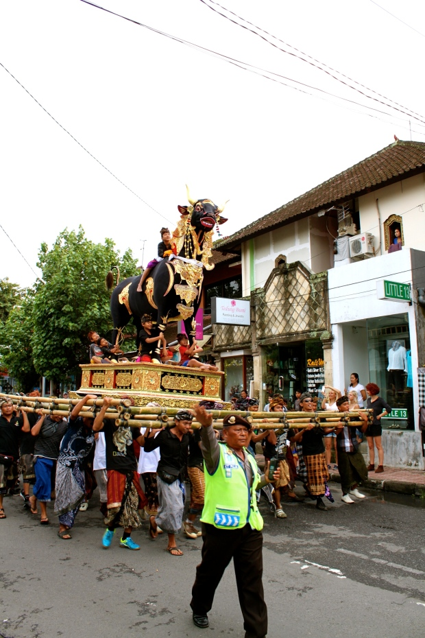 A funeral procession walking through central Ubud, Bali