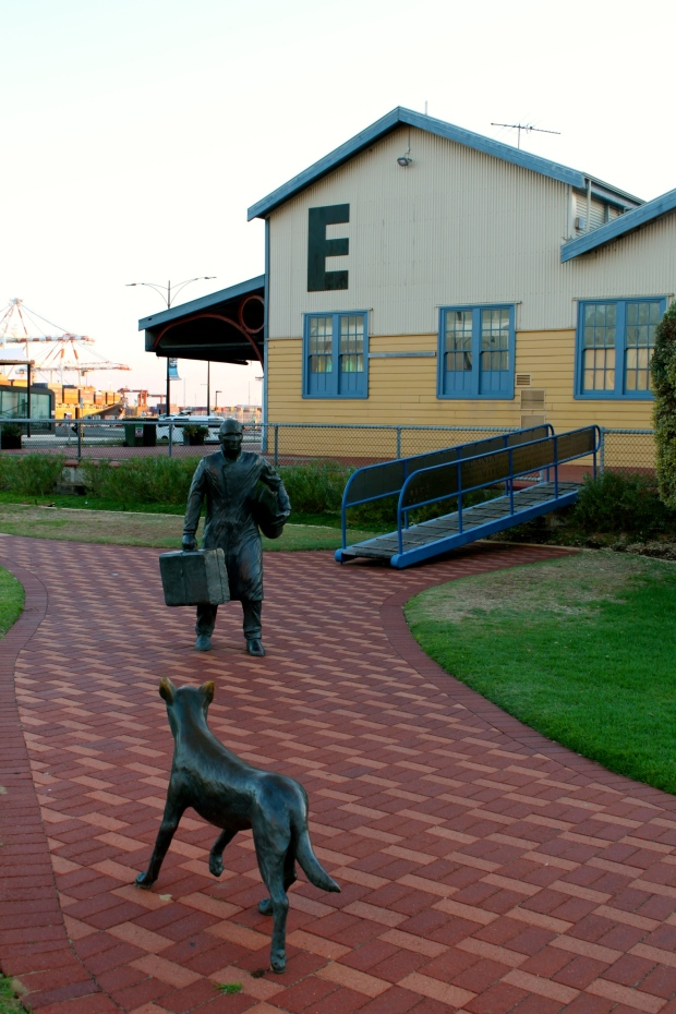 Statue of man and dog outside the ferry terminal in Fremantle