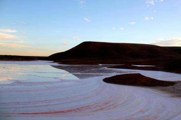 A salt lake as the sun goes down on The Ghan
