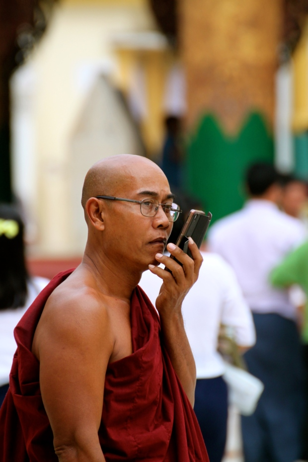 Monk on a mobile in Shwedagon Pagoda