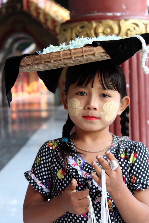 Little girl in Mandalay with her face painted