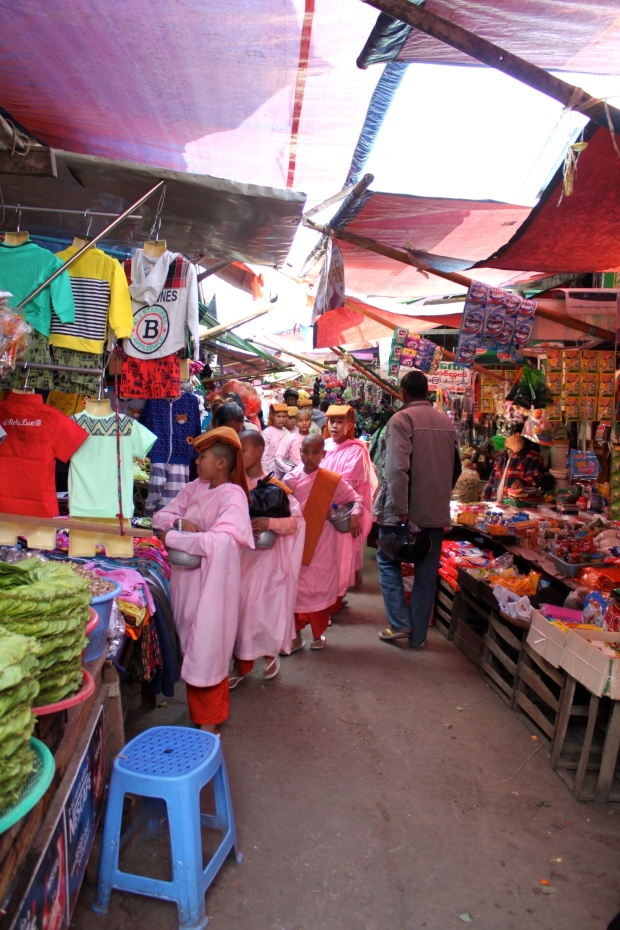 Nuns collecting in the market in Mandalay