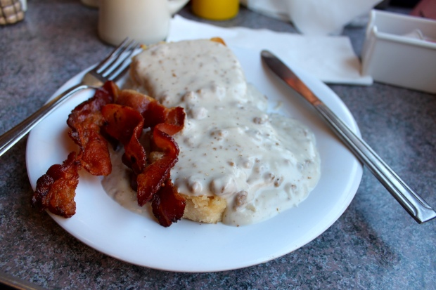 Southern biscuit with sausage gravy and crispy bacon